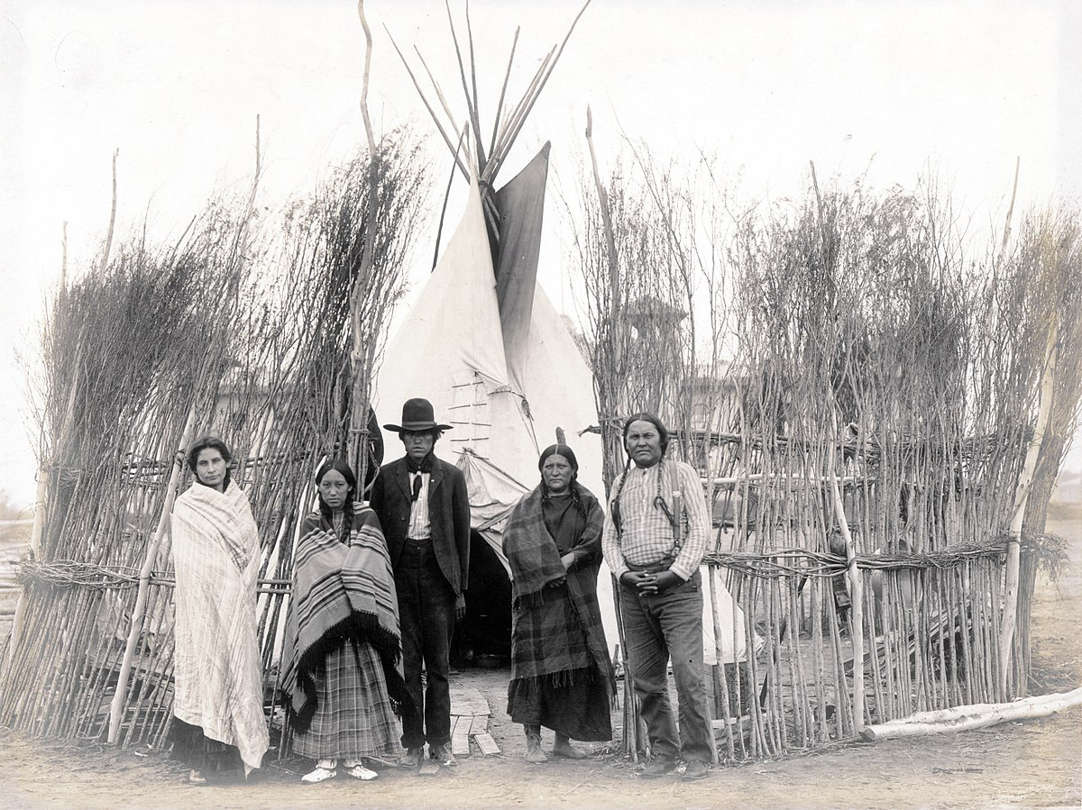 Arapaho family in front of a teepee at 1904 World's Fair